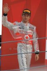 © Octane Photographic Ltd. 2011. Formula 1 World Championship – Italy – Monza – 11th September 2011 – Podium – Jenson Button (McLaren) walks onto the podium. Digital Ref : 0178CB1D4132