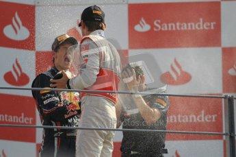 © Octane Photographic Ltd. 2011. Formula 1 World Championship – Italy – Monza – 11th September 2011 – Podium – Jenson Button (McLaren) sprays Sebastian Vettel (Red Bull) with champagne. Digital Ref : 0178CB1D4239
