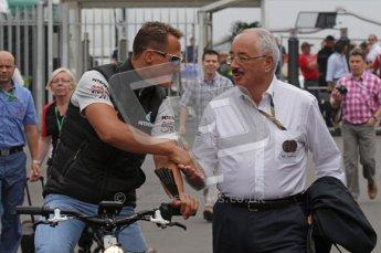© Octane Photographic Ltd. 2011. Formula 1 World Championship – Italy – Monza – 10th September 2011, Michael Shumacher shakes the FIA steward Paul Gutjahr's hand – Free practice 3 – Digital Ref :  0175LW7D5914