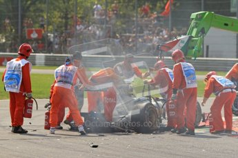 © Octane Photographic Ltd. 2011. Formula 1 World Championship – Italy – Monza – 11th September 2011 The marshalls connect Vitaly Petrov's wrecked Renault to the recovery crane – Race – Digital Ref : 0177CB7D7899
