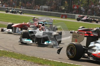 © Octane Photographic Ltd. 2011. Formula 1 World Championship – Italy – Monza – 11th September 2011 Debris is flicked up from the back of Lewis Hamilton;s McLaren as the safety car leads the pack around – Race – Digital Ref :  0177CB7D7932