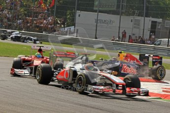 © Octane Photographic Ltd. 2011. Formula 1 World Championship – Italy – Monza – 11th September 2011 Mark webber mounts the curb in the 1st chicane trying to close in on Felipe Massa's Ferrari – Race – Digital Ref : 0177CB7D7978