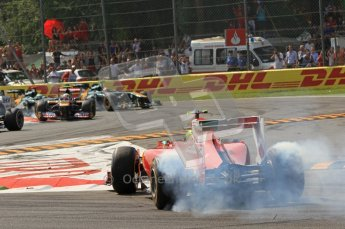 © Octane Photographic Ltd. 2011. Formula 1 World Championship – Italy – Monza – 11th September 2011 Felipe Massa spins up his rear wheel to point his Ferrari in the right direction after heavy contact by Mark Webber's Red Bull – Race – Digital Ref :  0177CB7D7993