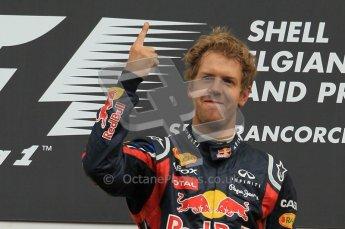 © Octane Photographic Ltd. 2011. Formula One Belgian GP – Spa – Sunday 28th August 2011 – The famous finger. Sebastian Vettel on the podium. Digital Reference : 0169CB1D