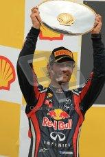© Octane Photographic Ltd. 2011. Formula One Belgian GP – Spa – Sunday 28th August 2011 – mark webber hoists his trophy on the podium. Digital Reference : 0169cb1d1076
