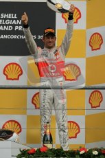 © Octane Photographic Ltd. 2011. Formula One Belgian GP – Spa – Sunday 28th August 2011 – Jenson Button hoists his trophy on the podium. Digital Reference : 0169cb1d1086