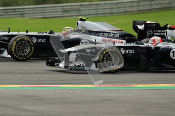 © Octane Photographic Ltd. 2011. Formula One Belgian GP – Spa – Sunday 28th August 2011 – Race. Williams battle - Pastor Maldonado overtakes Rubens Barrichello in their sister Williams FW33s. Digital Reference : 0168cb1d0453