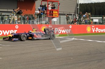 © Octane Photographic Ltd. 2011. Formula One Belgian GP – Spa – Sunday 28th August 2011 – Race. Sebastian Vettel takes the chequered flag waved by John Surtees. Digital Reference : 0168cb7d0977
