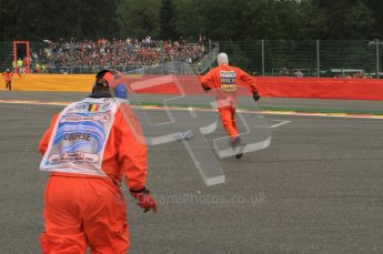 © Octane Photographic Ltd. 2011. Formula One Belgian GP – Spa – Sunday 28th August 2011 – Race. The marshalls sprint to pick up the post corner 1 debris. Digital Reference : 0168lw7d8556