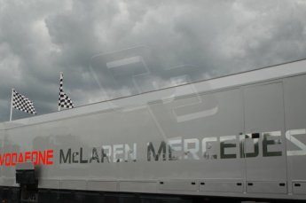 © Octane Photographic 2011. Goodwood Festival of Speed, Thursday 30th June 2011. Vodafone McLaren Mercedes and storm slouds. Digital Ref : 0097CB1D9914