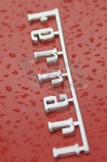 © Octane Photographic 2011 – Goodwood Revival 17th September 2011. Ferrari badge in the rain, Historic F1. Digital Ref : 0179CB1D4500