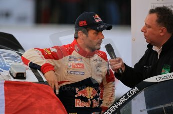 © North One Sport Ltd 2011 / Octane Photographic Ltd 2011. 13th November 2011 Wales Rally GB, Podium. Newly Crowned 8 times champions Sebastien Loeb being interviewed on the podium. Digital Ref : 0201cb1d9835