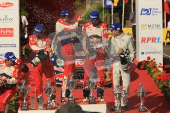 © North One Sport Ltd.2011/Octane Photographic Ltd. WRC Germany – Final Podium - Sunday 21st August 2011. Daniel Elena; Sebastien Loeb; Julian Ingrassia; Sebastien Ogier; and Daniel Sordo spraying the champaign. Digital Ref : 0153CB1D6467