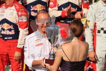 © North One Sport Ltd.2011/Octane Photographic Ltd. WRC Germany – Final Podium - Sunday 21st August 2011. Mossel Wine princess hands the winning constructors trophy to Olivier Quesnel. Digital Ref : 0153LW7D0134