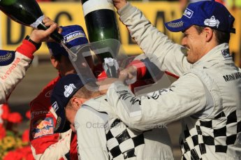 © North One Sport Ltd.2011/Octane Photographic Ltd. WRC Germany – Final Podium - Sunday 21st August 2011. Carlos Corral gets a bottle of champaign down the back of his neck from Daniel Sordo. Digital Ref : 0153LW7D0393