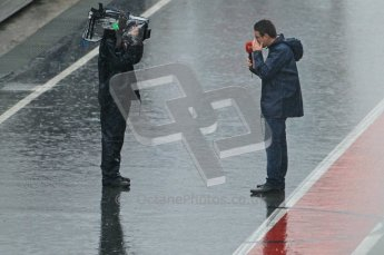 World © Octane Photographic 2011.  Formula 1 testing Saturday 12th March 2011 Circuit de Catalunya. Pitlane media interview in the wet. Digital ref : 0018CB1D4366