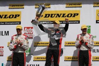 © Octane Photographic Ltd. BTCC - Round Two - Donington Park - Race 1. Sunday 15th April 2012. Mat Jackson, hoists the winners trophy as Matt Neal and Gordon Shedden applaud on the podium. Digital ref : 0295lw7d4197
