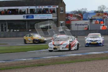 © Octane Photographic Ltd. BTCC - Round Two - Donington Park - Race 2. Sunday 15th April 2012. Mat Neal leads  Tony Hughes out of Redgate. Digital ref : 0296lw7d5042