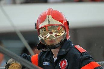 © Octane Photographic Ltd. 2012. F1 Monte Carlo - Practice 2. Thursday 24th May 2012. Monaco Fire Marshal in the rain. Digital Ref : 0352cb1d6066