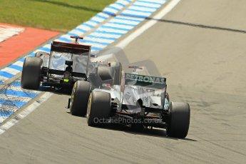 © 2012 Octane Photographic Ltd. German GP Hockenheim - Sunday 22nd July 2012 - F1 Race. McLaren MP4/27 - Jenson Button overtakes Michael Schumacher's Mercedes. Digital Ref : 0423lw1d5332