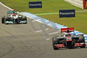 © 2012 Octane Photographic Ltd. German GP Hockenheim - Sunday 22nd July 2012 - F1 Race. McLaren MP4/27 - Jenson Button pulls away from Michael Schumacher's Mercedes. Digital Ref : 0423lw1d5352