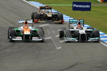 © 2012 Octane Photographic Ltd. German GP Hockenheim - Sunday 22nd July 2012 - F1 Race. Force India VJM05 - Nico Hulkenberg and the Mercedes W03 of Michael Schumacher side by side into the hairpin. Digital Ref : 0423lw1d5429