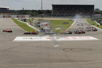 © 2012 Octane Photographic Ltd. German GP Hockenheim - Sunday 22nd July 2012 - F1 Race. The pack heads around the hairpin on the opening lap. Digital Ref : 0423lw7d8566
