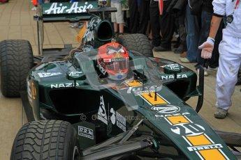 © 2012 Octane Photographic Ltd/ Carl Jones.  Heikki Kovalainen, Caterham T127, Goodwood Festival of Speed. Digital Ref: 0389cj7d7541