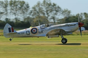 © 2012 Octane Photographic Ltd. Goodwood Revival. September 15th 2012. Spitfire landing. Digital Ref : 0521cb1d9878