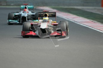 © 2012 Octane Photographic Ltd. Hungarian GP Hungaroring - Sunday 29th July 2012 - F1 Race. HRT F112 - Pedro de La Rosa about to be lapped by the Mercedes W03 of Michael Schumacher. Digital Ref :