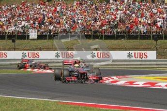 © 2012 Octane Photographic Ltd. Hungarian GP Hungaroring - Sunday 29th July 2012 - F1 Race. McLaren MP4/27 - Lewis Hamilton, Lotus E20 - Romain Grosjean and the other McLaren of Jenson Button. Digital Ref :
