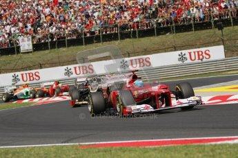 © 2012 Octane Photographic Ltd. Hungarian GP Hungaroring - Sunday 29th July 2012 - F1 Race. Ferrari F2012 - Fernando Alonso fends off Kimi Raikkonen's Lotus E20 and the rest of the pack. Digital Ref :