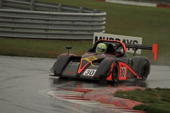 © Jones Photography. OSS Championship Round 1, Snetterton, 28th April 2012. Darcy Smith, Radical SR4. Digital Ref: 0390CJ7D0477