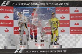 © 2012 Octane Photographic Ltd. British GP Silverstone - Sunday 8th July 2012 - GP2 Race 2 - Davide Valsecchi, Luiz Razia and Felipe Nasr spray champagne on the podium. Digital Ref : 0401lw7d7658