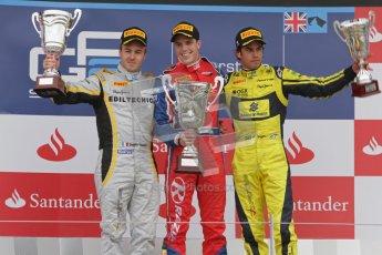 © 2012 Octane Photographic Ltd. British GP Silverstone - Sunday 8th July 2012 - GP2 Race 2 - Davide Valsecchi, Luiz Razia and Felipe Nasr rais their trophies on the podium. Digital Ref : 0401lw7d7674