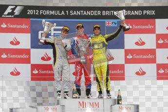 © 2012 Octane Photographic Ltd. British GP Silverstone - Sunday 8th July 2012 - GP2 Race 2 - Davide Valsecchi, Luiz Razia and Felipe Nasr rais their trophies on the podium. Digital Ref : 0401lw7d7682