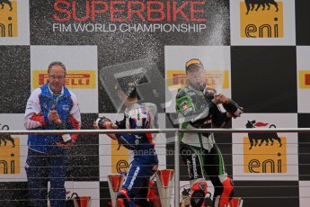 © Octane Photographic Ltd 2012. World Superbike Championship – European GP – Donington Park, Sunday 13th May 2012. Race 1 Podium. Marco Melandri and Tom Sykes spray their podium Champaign. Digital Ref : 0335lw7d7570