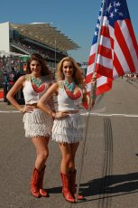 World © Octane Photographic Ltd. F1 USA GP, Austin, Texas, Circuit of the Americas (COTA), Sunday 17th November 2013 - Grid. The grid girls with US Flag. Digital Ref : 0860lw1d2600