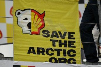 "World © Octane Photographic Ltd. F1 Belgian GP - Spa-Francorchamps, Sunday 25th August 2013 - Podium. Anti Shell Arctic drill activists Greenpeace ""Savethearctic.org"" protesting on podium. Digital Ref : 0798lw1d0652"
