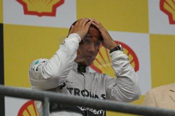 World © Octane Photographic Ltd. F1 Belgian GP - Spa-Francorchamps, Sunday 25th August 2013 - Podium. Mercedes AMG Petronas F1 W04 – Lewis Hamilton (3rd). Digital Ref : 0798lw1d0653