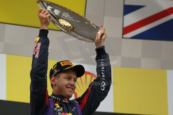 World © Octane Photographic Ltd. F1 Belgian GP - Spa-Francorchamps, Sunday 25th August 2013 - Podium. Infiniti Red Bull Racing RB9 - race winner Sebastian Vettel. Digital Ref : 0798lw1d0710