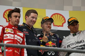 World © Octane Photographic Ltd. F1 Belgian GP - Spa-Francorchamps, Sunday 25th August 2013 - Podium. Infiniti Red Bull Racing RB9 - race winner Sebastian Vettel, Scuderia Ferrari F138 - Fernando Alonso (2nd) .  and Mercedes AMG Petronas F1 W04 – Lewis Hamilton (3rd) on the podium. Digital Ref : 0798lw1d0828
