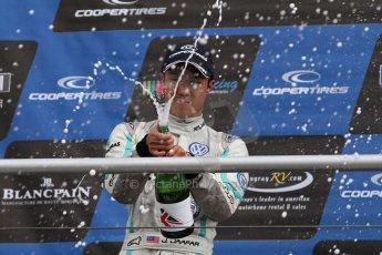 World © Octane Photographic Ltd. British Formula 3 – Brands Hatch. Saturday 10th August 2013 – Race 1. Race winner Jazeman Jaafar celebrates on the International Class podium – Carlin – Dallara F312 Volkswagen. Digital Ref : 0777lw7d1270