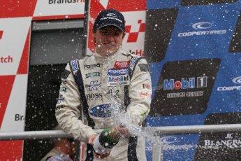 World © Octane Photographic Ltd. British Formula 3 – Brands Hatch. Saturday 10th August 2013 – Race 1. Jordan King celebrates his 2nd place in the podium – Carlin – Dallara F312 Volkswagen. Digital Ref : 0777lw7d1286