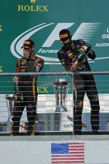 World © Octane Photographic Ltd. F1 USA GP, Austin, Texas, Circuit of the Americas (COTA), Sunday 17th November 2013 - Podium. Lotus F1 Team - Romain Grosjean (2nd) and Infiniti Red Bull Racing - Mark Webber (3rd). Digital Ref : 0862lw1d6432