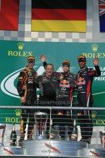 World © Octane Photographic Ltd. F1 USA GP, Austin, Texas, Circuit of the Americas (COTA), Sunday 17th November 2013 - Podium. Infiniti Red Bull Racing - Sebastian Vettel (1st), Lotus F1 Team - Romain Grosjean (2nd) and Infiniti Red Bull Racing - Mark Webber (3rd). Digital Ref : 0862lw1d6459