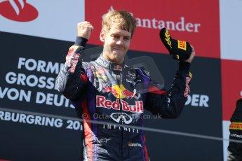 World © Octane Photographic Ltd. F1 German GP - Nurburgring. Sunday 7th July 2013 - Podium. Infiniti Red Bull Racing - Race Winner Sebastian Vettel. Digital Ref : 0750au8i0343