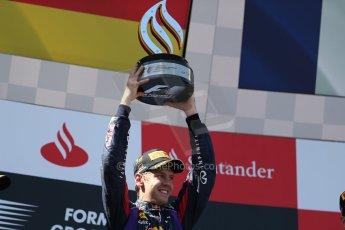 World © Octane Photographic Ltd. F1 German GP - Nurburgring. Sunday 7th July 2013 - Podium. Infiniti Red Bull Racing - Race Winner Sebastian Vettel. Digital Ref : 0750au8i0404