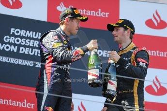 World © Octane Photographic Ltd. F1 German GP - Nurburgring. Sunday 7th July 2013 - Podium. Infiniti Red Bull Racing - Race Winner Sebastian Vettel and Lotus F1 Team's Romain Grosjean. Digital Ref : 0750au8i0595