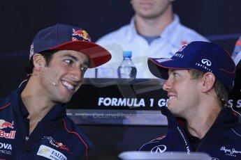 World © Octane Photographic Ltd. F1 German GP - Nurburgring. Thursday 4th July 2013 - Press Conference. Infiniti Red Bull Racing RB9 - Sebastian Vettel talking with Scuderia Toro Rosso STR 8 - Daniel Ricciardo. Digital Ref : 0738lw1d2929